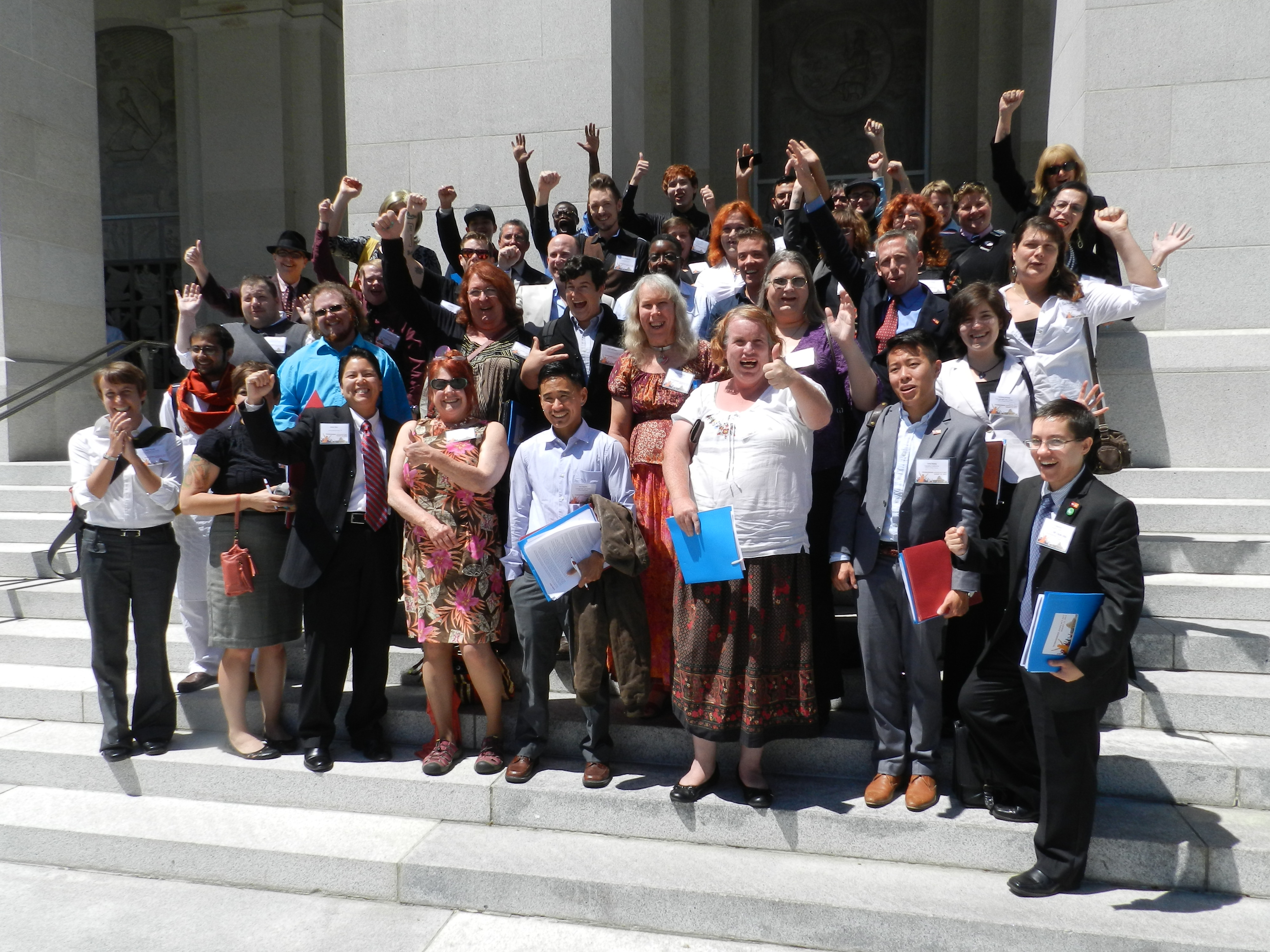 Image: Approximately 50 California Transgender Advocacy Day Citizen Lobbyists Cheering At The News Governor Brown Signed AB 1266 (The School Success and Opportunity Act) On August 12, 2013