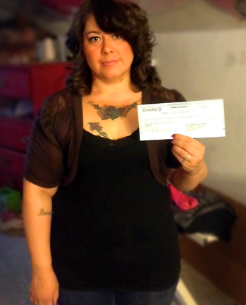 Proof of donation: Jane Doe's mom receives check.