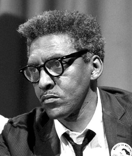 Thumbnail Link. IMAGE: Rustin at a news briefing on the Civil Rights March on Washington, August 27, 1963 (creative commons image). LINK: Brother Outsider, About Bayard Rustin